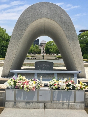 Hiroshima :through the cenotaph, you can see the Flame of Peace and the Atomic Dome in the distance.