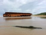 Freighter torn violently in half - lengthwise
